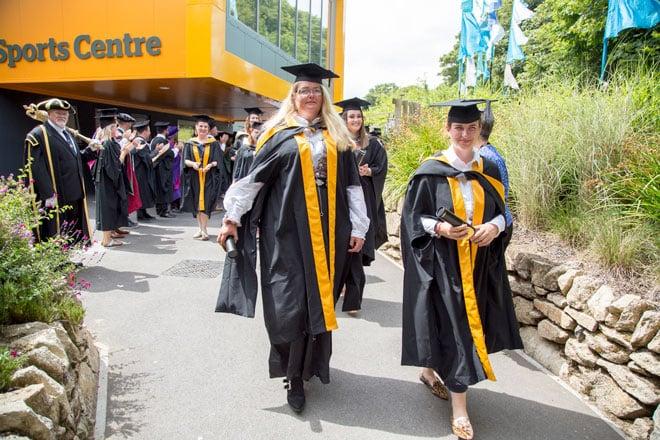 Grads leaving ceremony